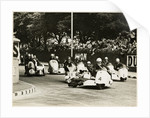 L. Neusser, driving a BMW sidecar outfit leads the field around Parkfield Corner, following the mass start of the1958 Sidecar TT by T.M. Badger