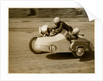 Eric Oliver driving sidecar outfit (number 16), 1958 (?) Sidecar TT (Tourist Trophy) by T.M. Badger