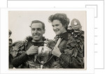 Sidercar TT (Tourist Trophy) crew holding a silver cup by T.M. Badger