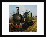 Air hostess hanging-off side of steam train by Manx Press Pictures