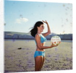 Glamour girl on Douglas beach with beachball by Manx Press Pictures