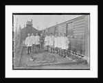 First World War Internee in front of hut with medical/hospital staff, Camp 2, Knockaloe by W H Warburton