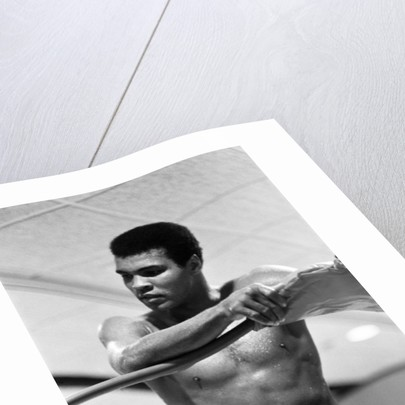 Muhammad Ali takes a breather from trainnig by Cyril Maitland