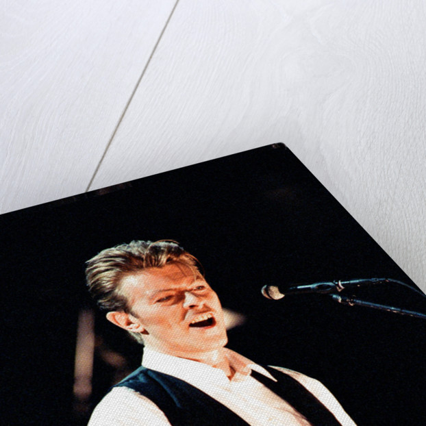 David Bowie performing at The Birmingham NEC, as part of his 1990 Sound and Vision World Tour. by Dick Williams