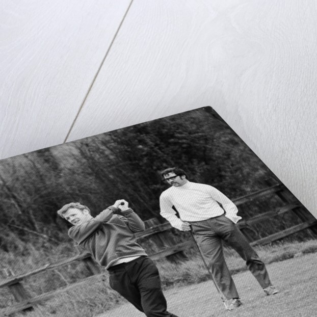 Billy Bremner tees off watched by Denis Law by Monte Fresco