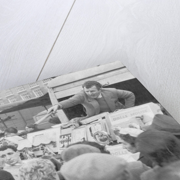 A stall holder at Petticoat Lane market by Anonymous