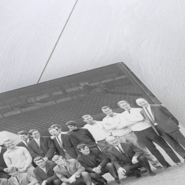 1964...and a couple of strangers have slipped into the team picture as Manchester United report back for training by Staff