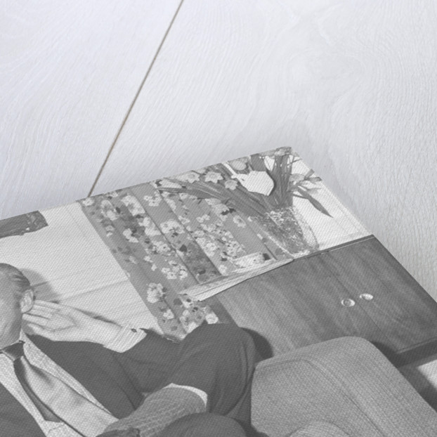 David Niven relaxes in his hotel suite in London by Anonymous