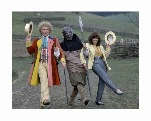 """Colin Baker with Nicola Bryant who plays Perpugilliam """"Peri"""" Brown during filming at Butser Ancient Farm Project, Butser Hill, Hampshire for the story The Mysterious Planet, part of the larger Trial of A Time Lord narrative. 10th April 1986. by Anonymous"""