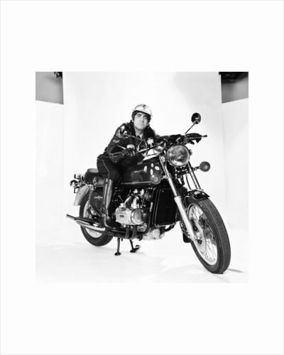 Keith Moon on motorbike 1976 by Ron Burton
