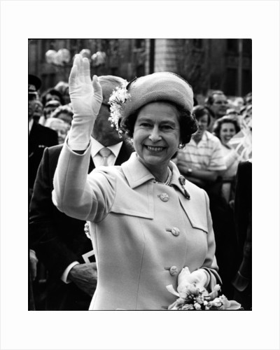 Queen Elizabeth II smiles and waves farewell to the crowdoutside the Law Courts. Liverpool by Staff