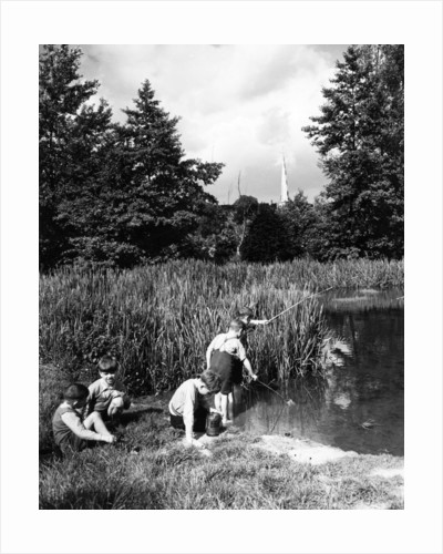 Boys fishing in the river circa 1939 by Staff