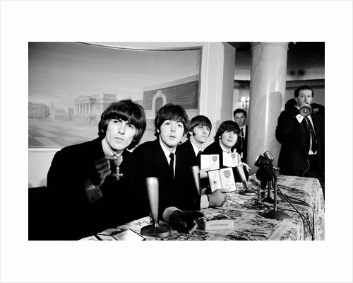 The Beatles pose with their MBEs by Gavin