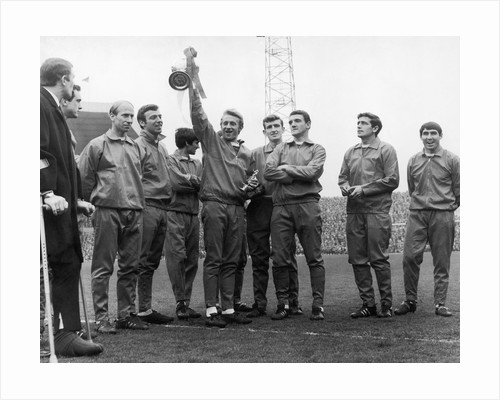 Dennis Law holding the Division One Championship trophy by Staff