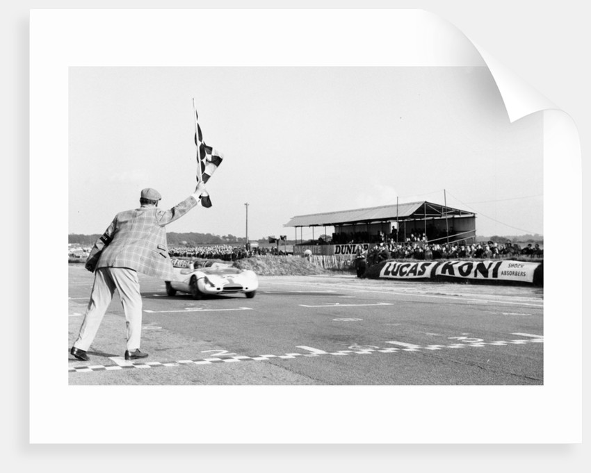 Jim Clark takes the checkered flag by Staff