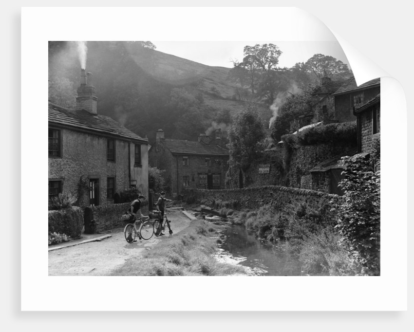 Two boys out on their bicycles near a stream in the Peak District village of Castletown by Anonymous