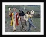 "Colin Baker with Nicola Bryant who plays Perpugilliam ""Peri"" Brown during filming at Butser Ancient Farm Project, Butser Hill, Hampshire for the story The Mysterious Planet, part of the larger Trial of A Time Lord narrative. 10th April 1986. by Anonymous"