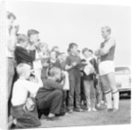 Bobby Moore poses for young fans by Monte Fresco