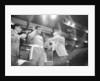 Muhammad Ali clowning around patting his hair. by Monte Fresco