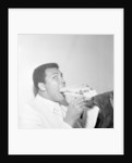 Muhammad Ali in Newcastle eating a Stottie cake 1977 by Dennis Hutchinson