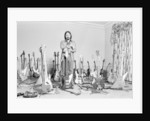 John Entwistle with bass guitars by George Phillips