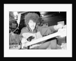 Phil Lynott of Thin Lizzy during a recording session for the groups new album. by Andy Hosie