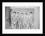 Ken Dodd (centre) posing with Madame Tussauds figures of The Beatles. Picture taken on the set of Juke Box Jury, that Ken Dodd is filming. by Staff