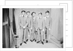 Ken Dodd posing with Madame Tussauds figures of The Beatles by Unknown