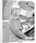 Elton John performing on stage at Wembley Stadium., London, England in June 1975 by Chris Barham