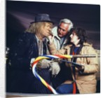 A make-up artist touches up Jon Pertwee's make-up by Anonymous