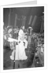 John Lennon and Yoko Ono on stage at the Lyceum. by Ray Weaver