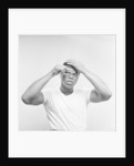 Cassius Clay combing his hair by Monte Fresco