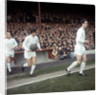 Johnny Aston leads Manchester United team mates onto the pitch by MSI