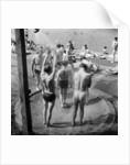 People sunbathing in a heatwave at the Serpentine Lido by Tommy Lea