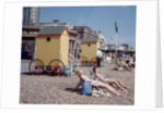 Old style bathing huts on the sea front at Brighton by Library