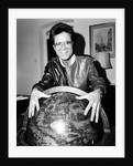 Cliff Richard with a globe by Anonymous