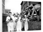 Navy cooks with Christmas puddings by Reg Lewis