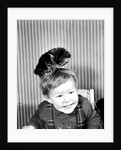 Baby boy with a kitten on his head by Anonymous