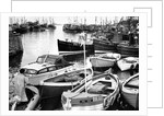 The crowded harbour at the coastal village of Seahouses by NCJ