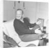 David Niven relaxing in his London hotel suite by Malcolm MacNeil