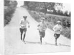 Apprentice jockeys jogging down a country lane by Staff