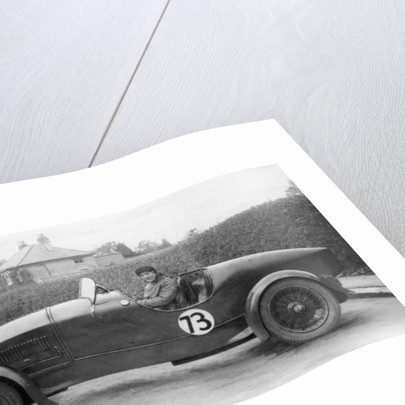 Amy Way seated in a racing car by Unknown