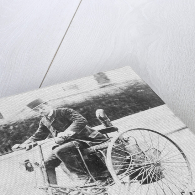 Leon Serpollet on his first steam tricycle by Anonymous