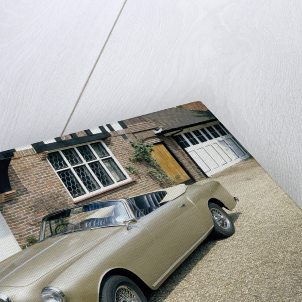 A 1963 Alvis car parked on a gravel driveway by Unknown