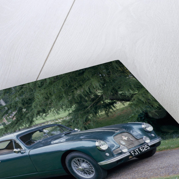 A 1952 Aston Martin DB2 saloon car photographed in a stately garden by Unknown