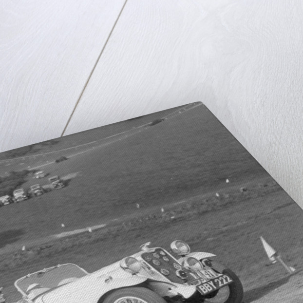 A Singer Nine Le Mans climbing a hill by Anonymous