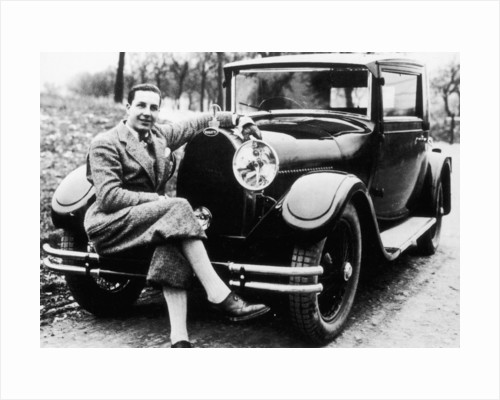Jean Bugatti pictured with a Bugatti car by Anonymous