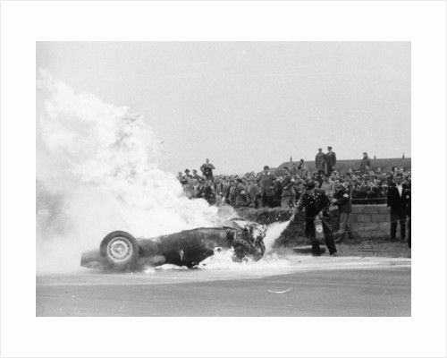 Tony Brooks' car on fire at the British Grand Prix by Anonymous