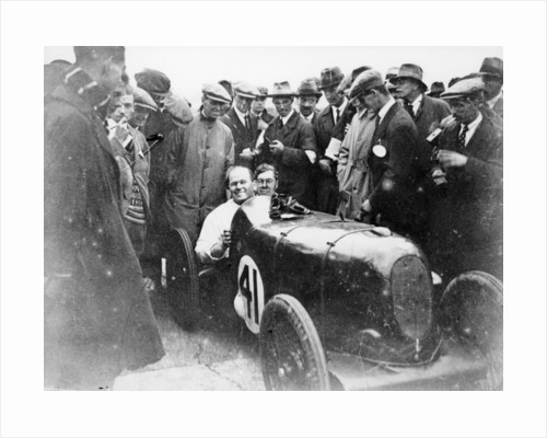 Gordon Taylor in a racing car surrounded by a crowd of men by Anonymous