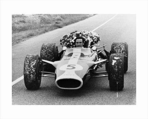 Jim Clark in a Lotus with the winner's laurel wreath by Anonymous